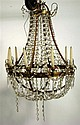 French Empire gilt bronze and cut glass luster strung thirteen arm chandelier, 19th century, The standard with heavy cast scrolling arm