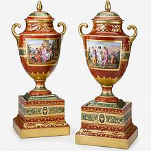 Pair of Vienna style porcelain urn and covers on stands, 19th century