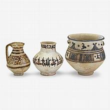 Three Persian slip-painted pottery vessels, circa 10th-12th century A.D.