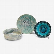 Three Kashan pottery bowls, circa 12th century