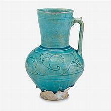 Turquoise glazed incised pottery jug, Persia, possibly Nishapur, circa 12th century