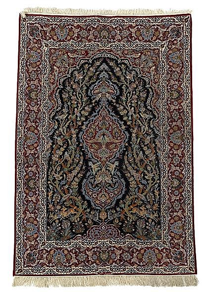 Isphahan carpet, central persia, circa 3rd quarter 20th century, With silk warps; inscribed.