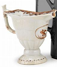 Chinese Export porcelain helmet-form creamer with eagle decoration, possibly for the American market, circa 1800,