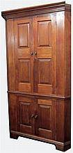 Walnut raised paneled door corner cupboard, pennsylvania, 18th century,