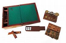 Group of boxes and scales: writing box, trick box, box with dominoes, and box with weights and associated scale, 19th century,