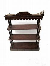 Hanging inlaid mahogany shelf with four graduated tiers and columnar supports, pedimented cresting, 19th century,