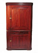 Provincial cherrywood two-part paneled door corner cupboard, early 19th century,