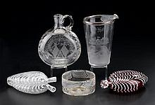 Five piece glass group: a blown red flask, uncolored double flask and bowl, a cocktail shaker with golf club house scene and a jug etch