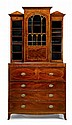 Late George III mahogany, satinwood, and rosewood inlaid secretaire bookcase, circa 1800, In two parts: the stepped cornice over breakf