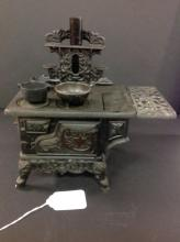 Antique Miniture Crescent Cast Iron Stove