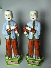 Antique porcelain standing figures.