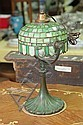 BOUDOIR LAMP. Green leaded and slag glass shade on a fluted bronze base. 16 1/4