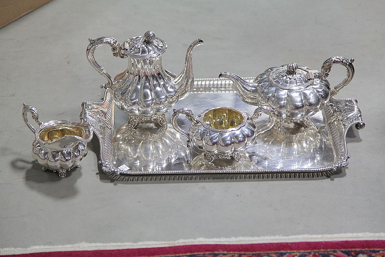 FOUR PIECE STERLING SILVER COFFEE/TEA SERVICE AND SILVER PLATED TRAY.