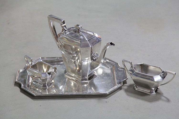 FOUR PIECE STERLING SILVER TEA SET.