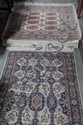 TWO ORIENTAL STYLE AREA RUGS.