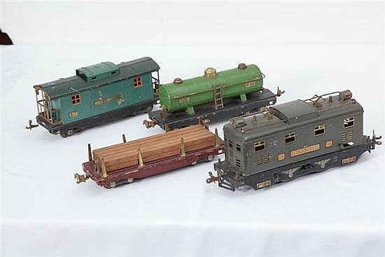 FOUR LIONEL TRAIN PIECES. O gauge. # 817 Caboose. 8 1/2