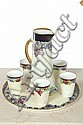 SEVEN PIECE LEMONADE SET. Assembled cream colored set having berry and leaf decoration with gilt accents. Pitcher. 11