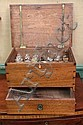 MEDICINE CHEST. Walnut with lift lid, ivory escutcheon and lower drawer. Contains various bottles for various remedies, some with pa...