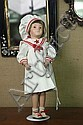 DOLL. Shoenhut compostion doll in red and white sailor outfit. Original paper label on back. 19