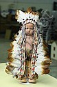 RARE LENCI CHARACTER DOLL. Felt American Indian with painted eyes, elaborate head dress and jointed at the neck and shoulders. Cardb...