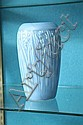 ROOKWOOD VASE. Blue vase with banded rim and embossed floral and foliate decoration. Signed for 1930, the