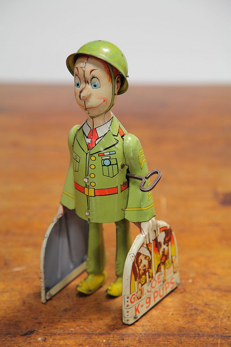 UNIQUE ART TIN WIND UP TOY.