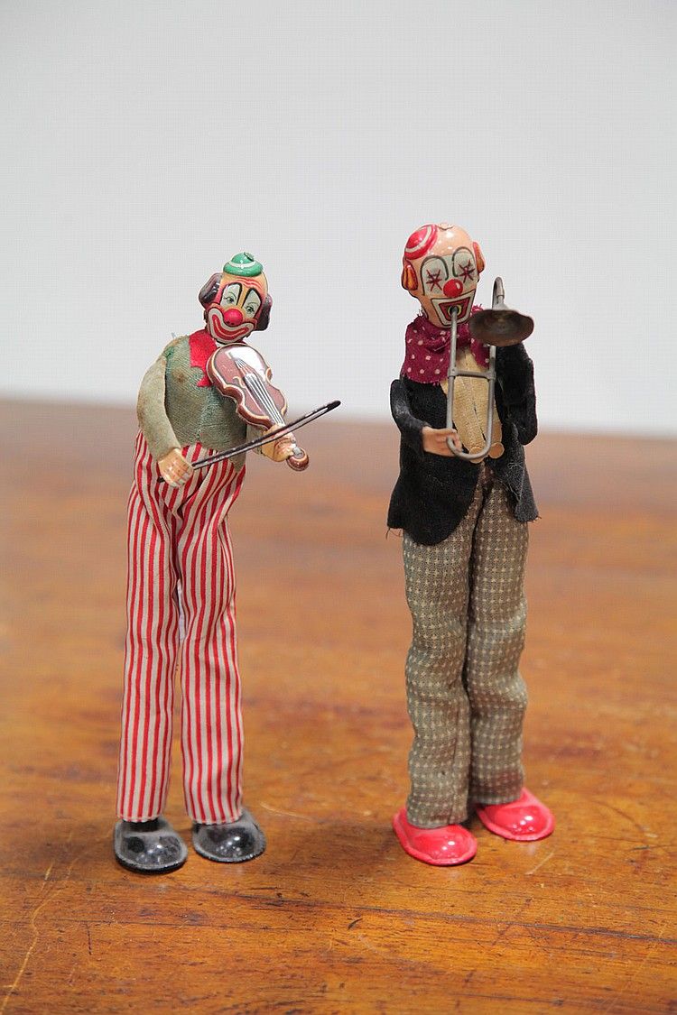 PAIR OF WIND-UP TIN CLOWNS.
