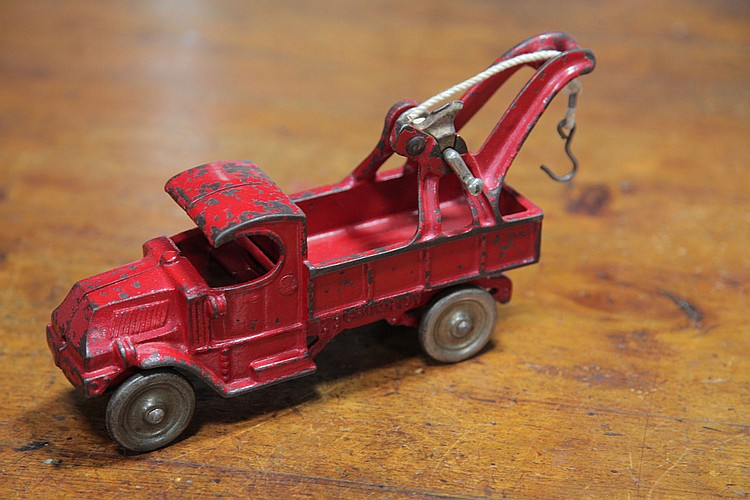 CHAMPION CAST IRON TOW TRUCK.