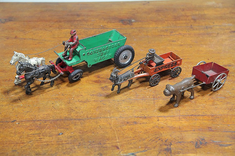 THREE CAST IRON WAGON TOYS.