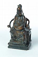 WOOD CARVING OF SEATED OFFICIAL.
