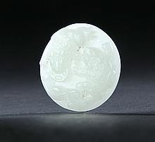 CARVED JADE DISK.