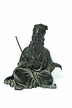 BRONZE FIGURE OF A MONK.