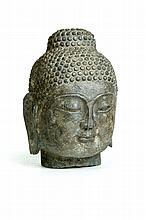 CARVED HEAD OF BUDDHA.