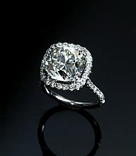 7.05 CT DIAMOND HALO RING.