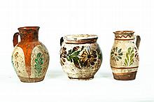 THREE DECORATED REDWARE PITCHERS.