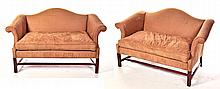 PAIR OF CHIPPENDALE-STYLE CAMELBACK SETTEES.