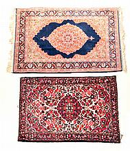 TWO HANDMADE ORIENTAL RUGS.