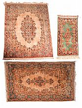 THREE RUGS.