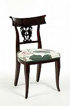 HEAVILY CARVED SIDE CHAIR.