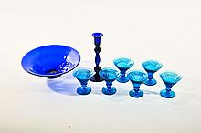 EIGHT PIECES OF BLUE GLASS.
