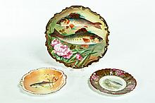 THREE HAND PAINTED PLATES.