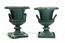 PAIR OF CAST IRON GARDEN URNS.