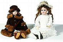 TWO BISQUE HEAD DOLLS..