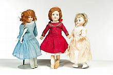THREE BISQUE HEAD DOLLS.