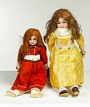 TWO BISQUE HEAD DOLLS.