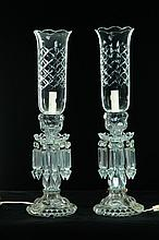 PAIR OF CANDLEHOLDERS WITH CUT GLASS SHADES.