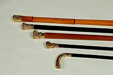 FIVE CANES WITH CHASED GOLD FILLED HANDLES.