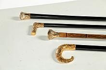 FOUR CANES WITH CHASE GOLD FILLED HANDLES.