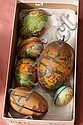 SEVEN EASTER EGG CANDY CONTAINERS. Six are paper mache with various holiday decorations. One is tin. Largest 5