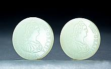 RARE PAIR OF CHINESE WHITE JADE COINS.